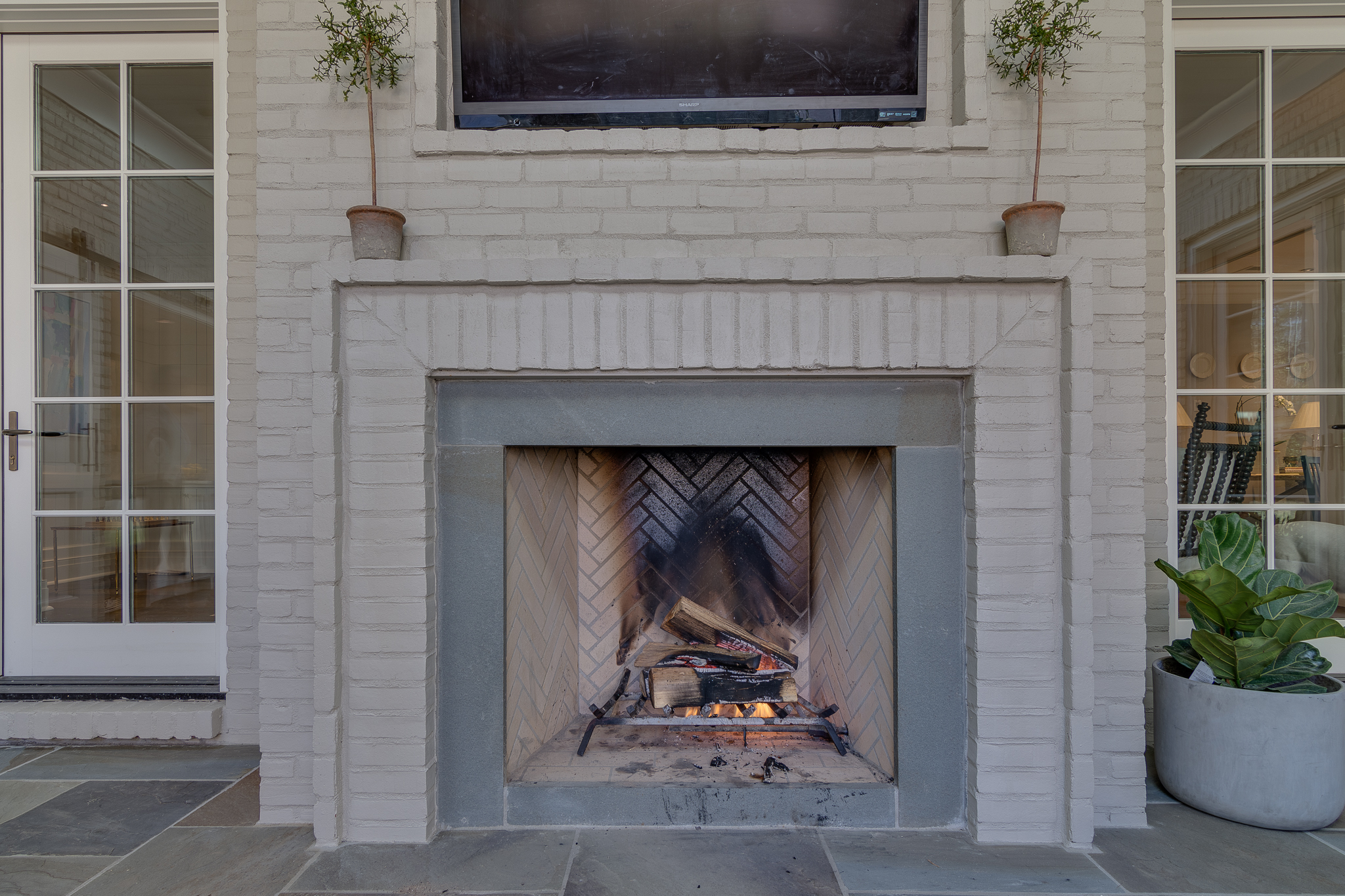 outdoor isokern wood burning fireplace in use in memphis home