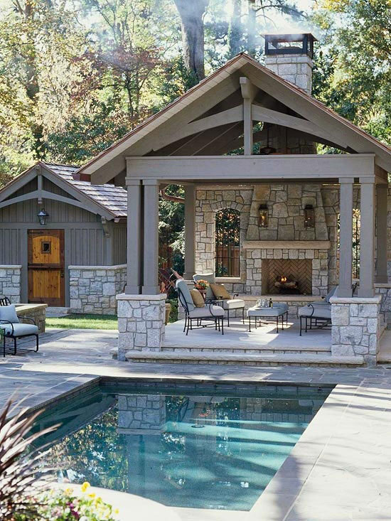 outdoor isokern fireplace with patio furniture by pool in Memphis