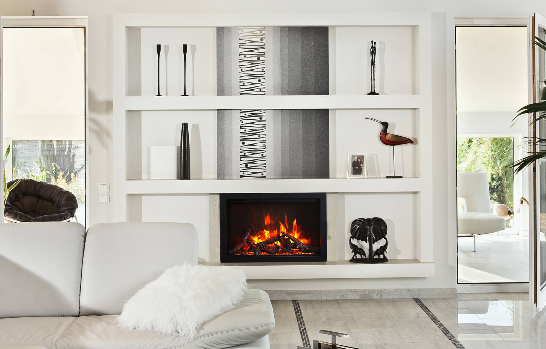 smaller electric fireplace set into shelving