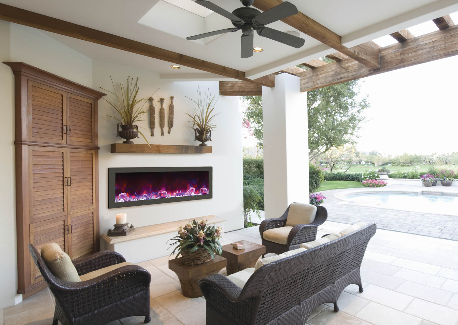 long outdoor electric fireplace set into wall