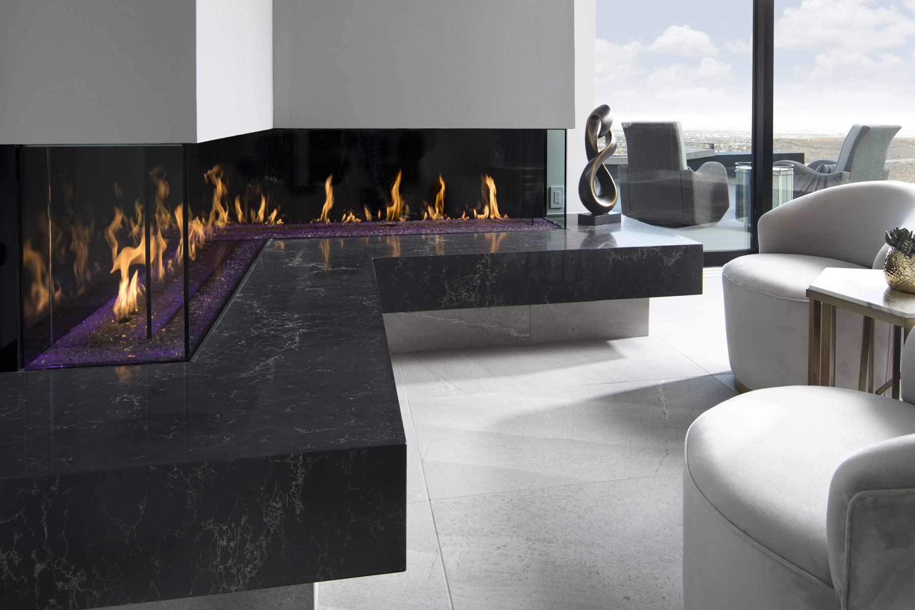 long l shaped custom fireplace across big countertop