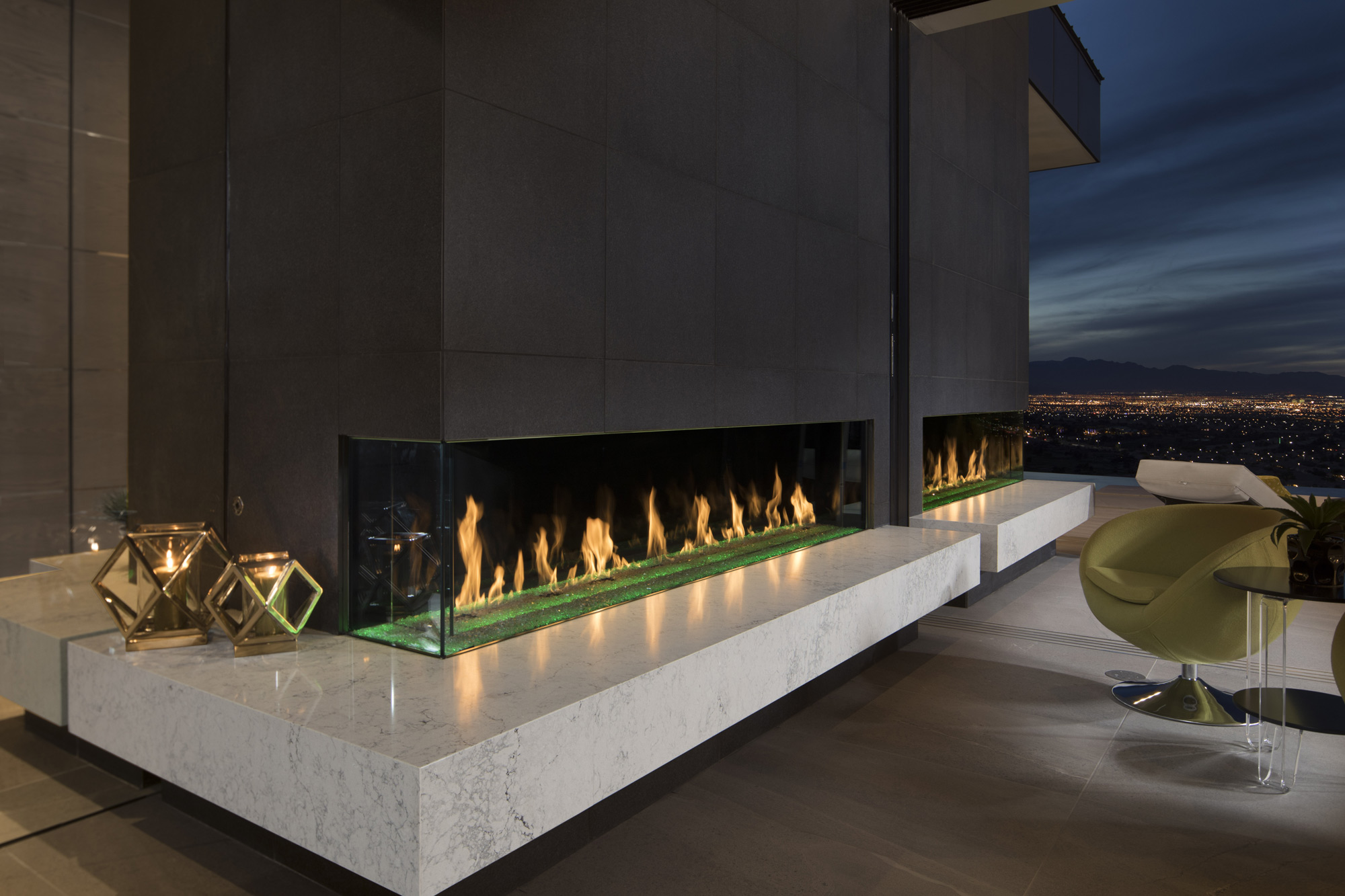 twin custom outdoor fireplaces spanning entire length of roof deck